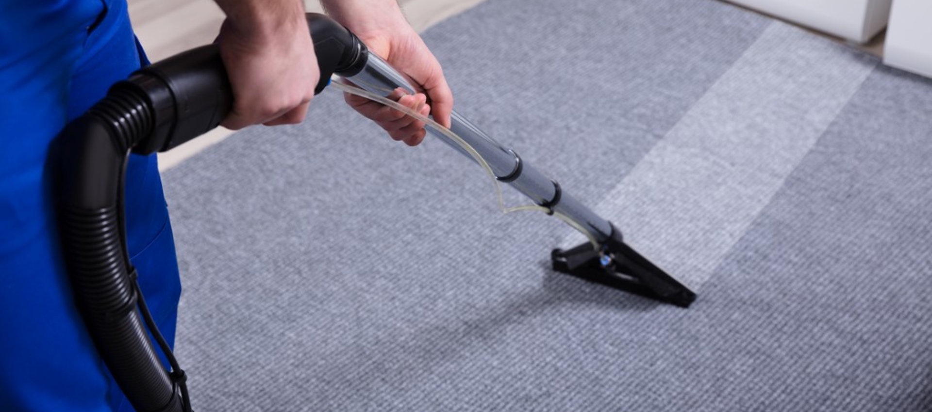 housekkeeping cleaning a carpet