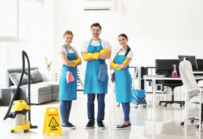 team of cleaners in office