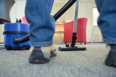 cleaning the carpet using a vacuum cleaner