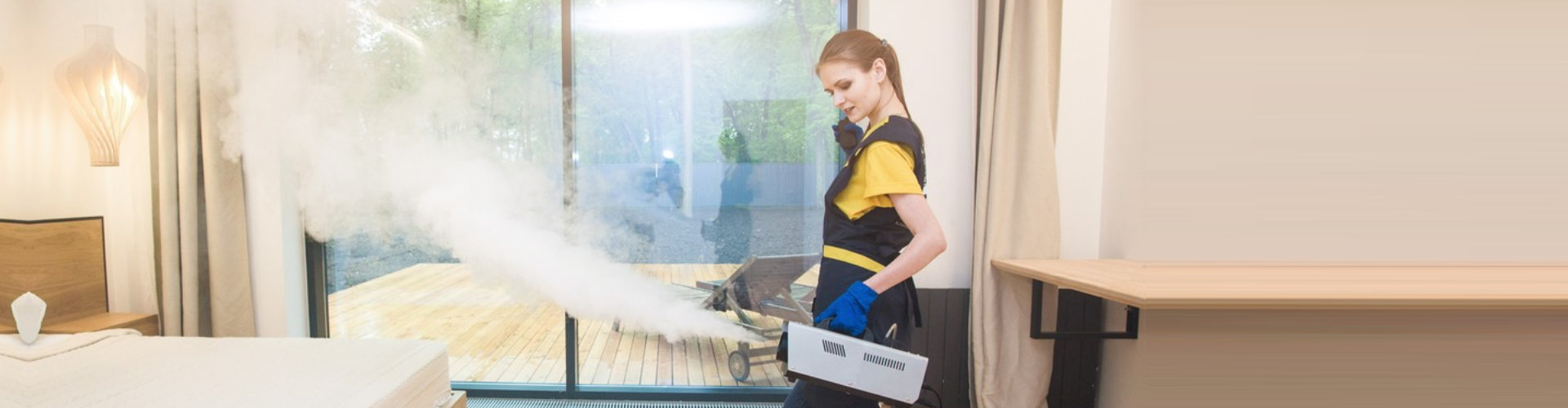 woman in uniform and gloves does the hot steam