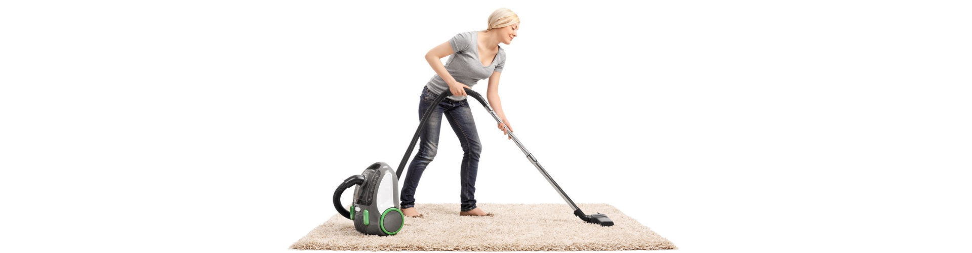 housekeeping cleaning the carpet using a vacuum cleaner